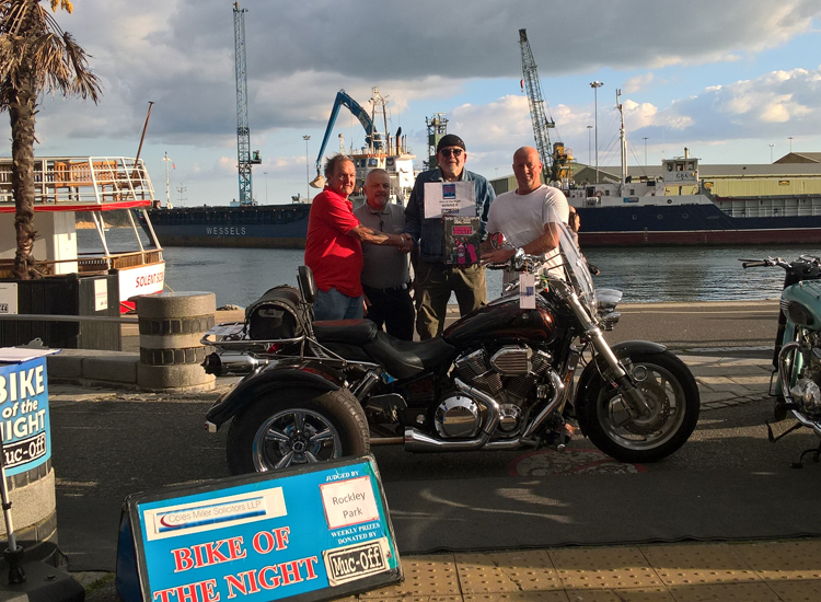 Winner of Bike of the Night pictured on Poole Quay with Judge and motorbike.