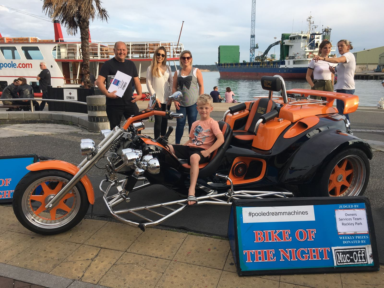 Winning motorbike pictured on Poole Quay with people around it.