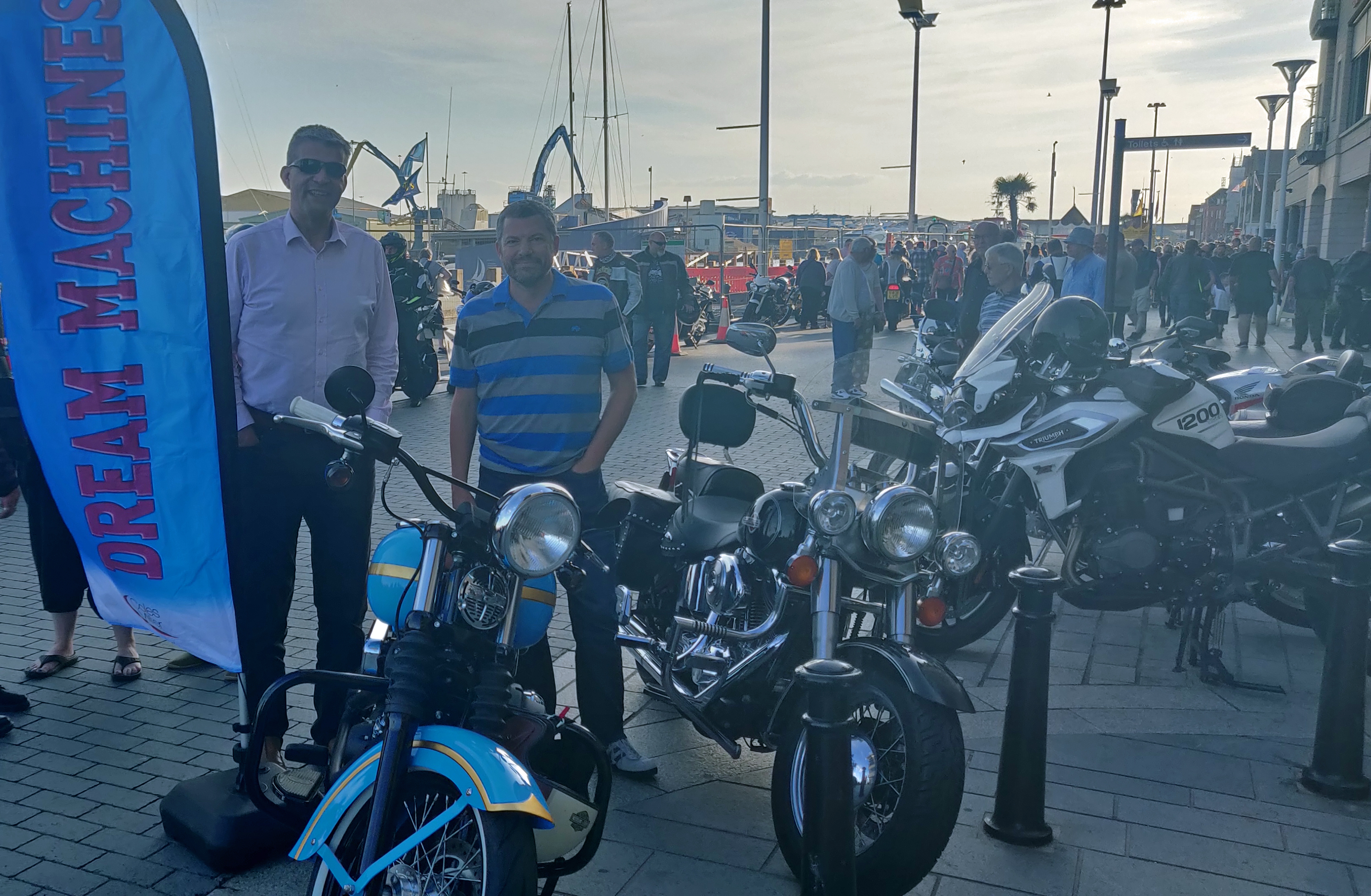 Bike of the Night winner pictured with motorbike on Poole Quay