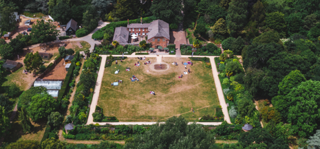 Aerial view of Upton Country Park, grass and building in view