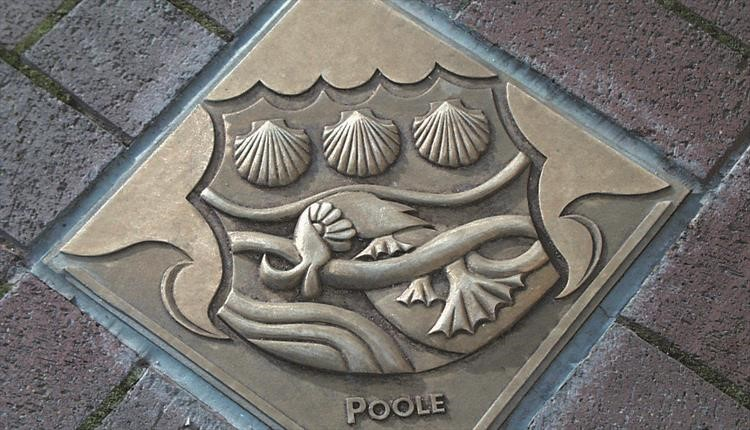 Poole crest in brick road