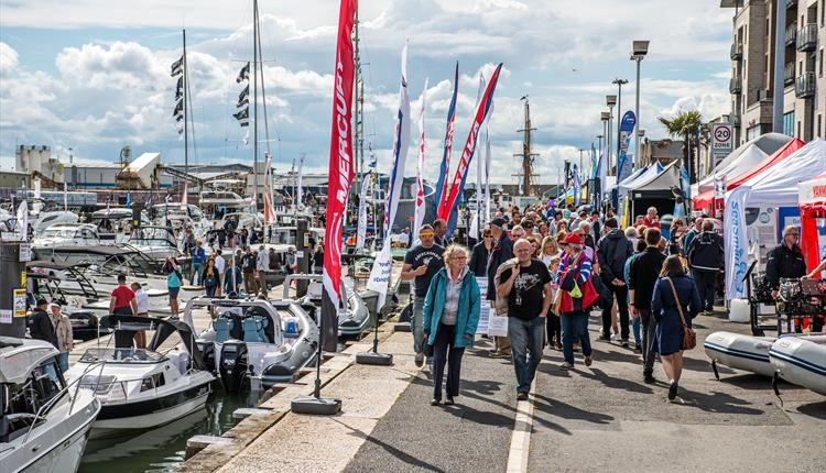 Crowds of people taking in the sights at Poole Harbour Boat Show