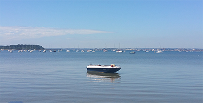 Small boat on the water in Poole Harbour