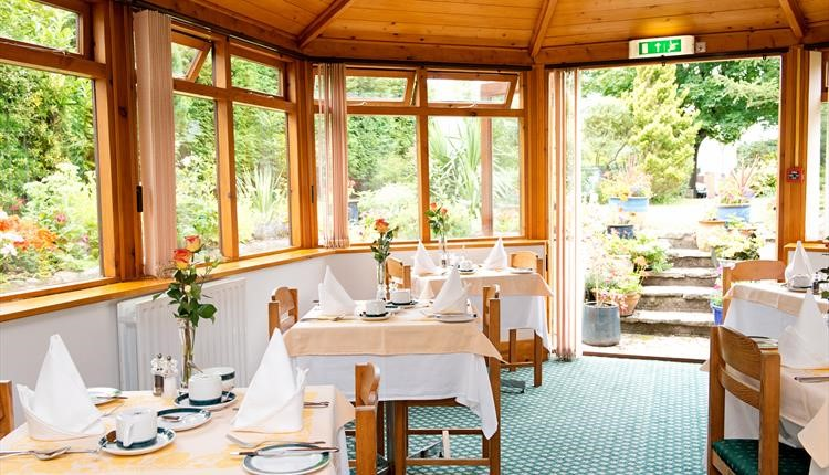 Winter Dene's stunning and open breakfast room next to their gardens.