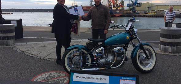 Bike Winner pictured on Quay with judge.