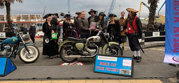 Pirates around winning bike on Poole Quay