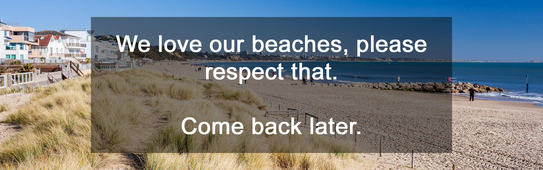 Landscape view of Sandbanks Beach blocked by black text box containing message: 'We love our beaches, please respect that. Come Back Later.'