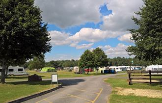 Sunny shot of tents and caravans pitched up at the park