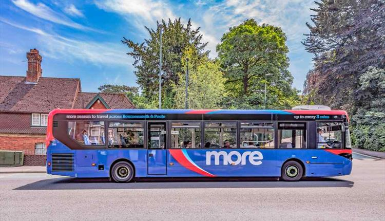 A colourful morebus bus driving passengers around Poole