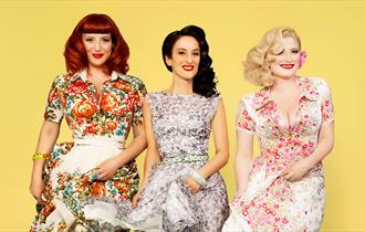 The Puppini Sisters photo in bright floral dresses