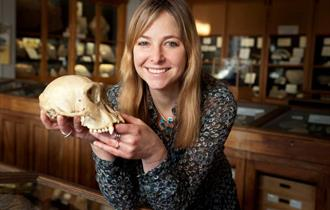 photo of Alice Roberts on tour with a skull