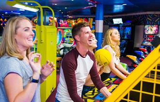 Bournemouth Pier Arcade family playing sports game yellow ball