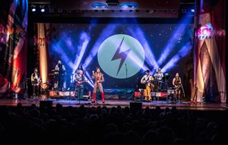 photo of the stage during the Bowie experience with David Bowie's famous lightening symbol.