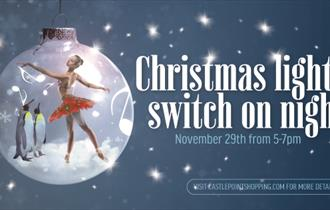 Ballerina and two penguins in a bauble with the text christmas lights switch on night.