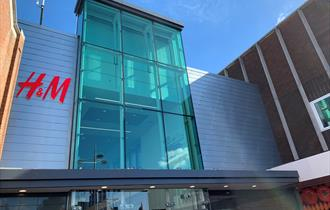 Dolphin Shopping centre glass exterior showing H&M