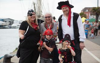 Family dressed up as pirates.
