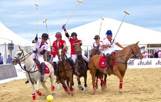 Beach Polo riders on horseback.