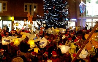 Poole residents celebrate the hanging of lanterns around the Christmas tree.