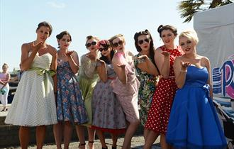 Group of ladies posing for a photo at Poole goes vintage