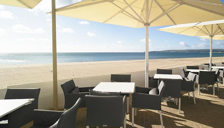 Sandbanks Hotel Terrace overlooking beach