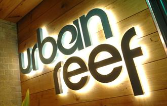 Urban Ree's logo on the front of the restaurant in Bournemouth