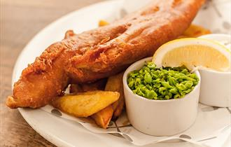 Fresh fish and chips and peas