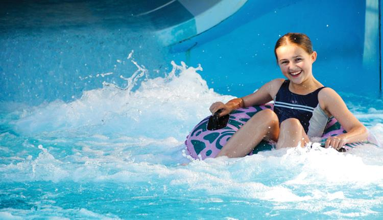 Child floating on a ride at splashdown in Poole