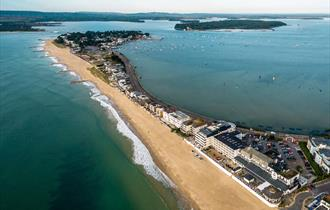 Beautiful birds eye view of a stretch of Sandbanks beach on a clear summers day in Poole